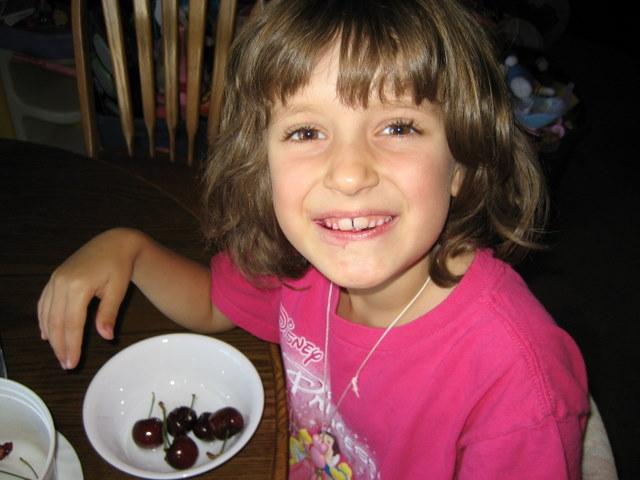 Rachel eating cherries