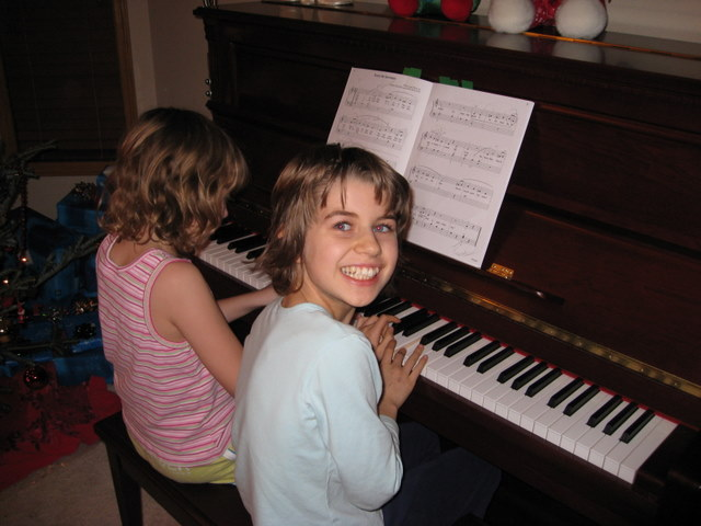 Sarah helping Sydney play the piano